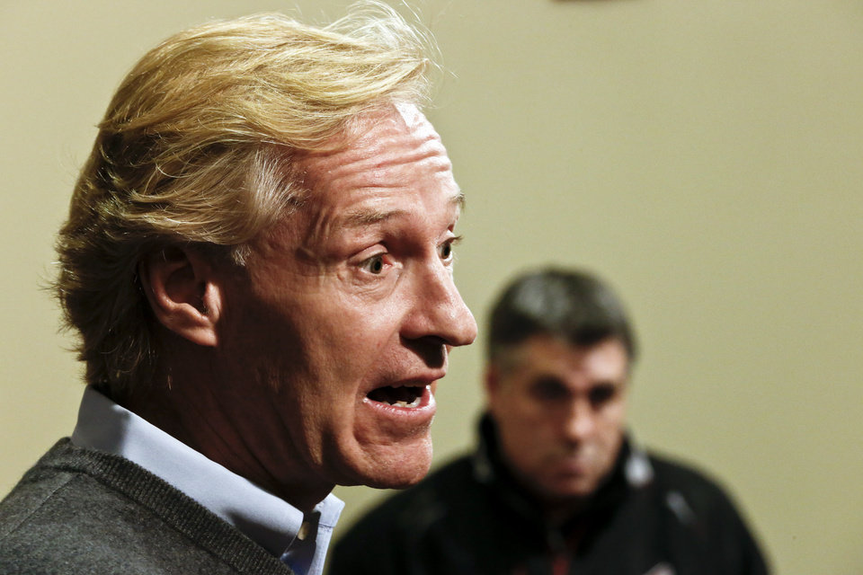 Photo - Phoenix Coyotes' general manager Don Maloney, left, talks and head coach Dave Tippett looks on as Maloney talks about the upcoming NHL hockey season at a news conference, Thursday, Jan. 10, 2013, Glendale, Ariz.(AP Photo/Ross D. Franklin)