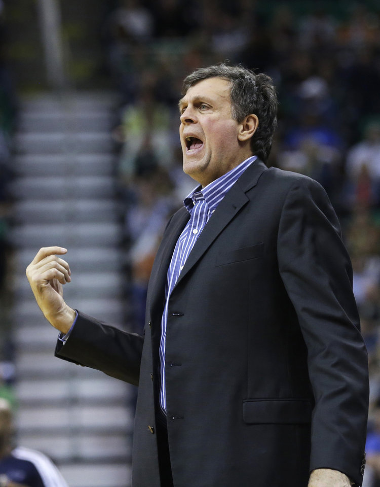 Photo - Houston Rockets head coach Kevin McHale shouts to his team in the second quarter during an NBA basketball game against the Utah Jazz, Saturday, Nov. 2, 2013, in Salt Lake City.  (AP Photo/Rick Bowmer)