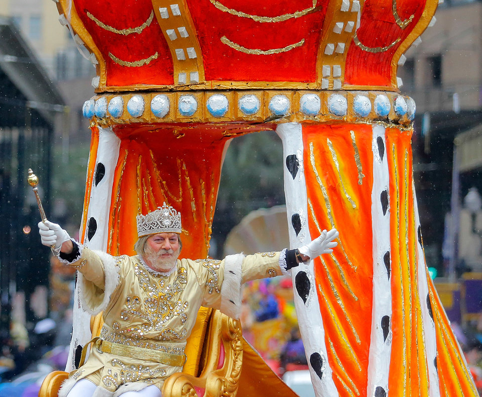 Photo - Jack Laborde, king of Carnival, greets his subjects on Mardi Gras during the Rex parade, Tuesday, March 4, 2014, in New Orleans. (AP Photo/NOLA.com The Times-Picayune, David Grunfeld) MAGS OUT; NO SALES; USA TODAY OUT; THE BATON ROUGE ADVOCATE OUT