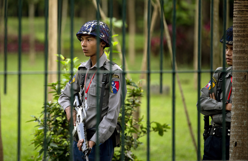 Photo -   Police officers stand guard in a park opposite the Yangon Parliament house where President Barack Obama is scheduled to meet Myanmar's President Thein Sein in Yangon, Myanmar, Monday, Nov. 19, 2012. Obama was set to become the first U.S. president to visit Myanmar with Air Force One scheduled to touch down in Yangon on Monday morning. (AP Photo/Gemunu Amarasinghe)