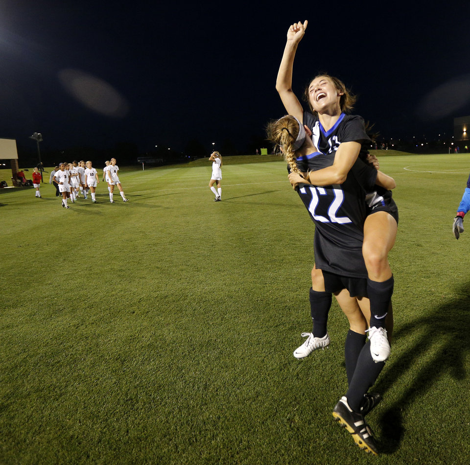 Photo - Deer Creek's and Mikayla Lowery, facing camera, and Madison Motil celebrate following their win in the Class 5A girls state soccer championship between Deer Creek and Carl Albert in Norman, Okla., Saturday, May 17, 2014. Photo by Bryan Terry, The Oklahoman