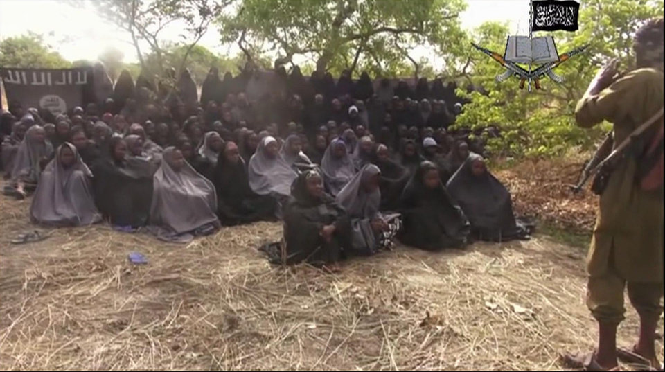 Photo - FILE - This file photo taken from video by Nigeria's Boko Haram terrorist network on Monday, May 12, 2014, shows the missing girls alleged to be abducted on April 14 from the town of Chibok in northeastern Nigeria. Freeing the 276 Nigerian girls from the terrorist group Boko Haram is now one of the U.S. government's top priorities, U.S. officials declared on Thursday, May 15, issuing warnings about the militant group's expanding reach and growing capacity for more sophisticated and deadlier terror attacks. (AP Photo/File)