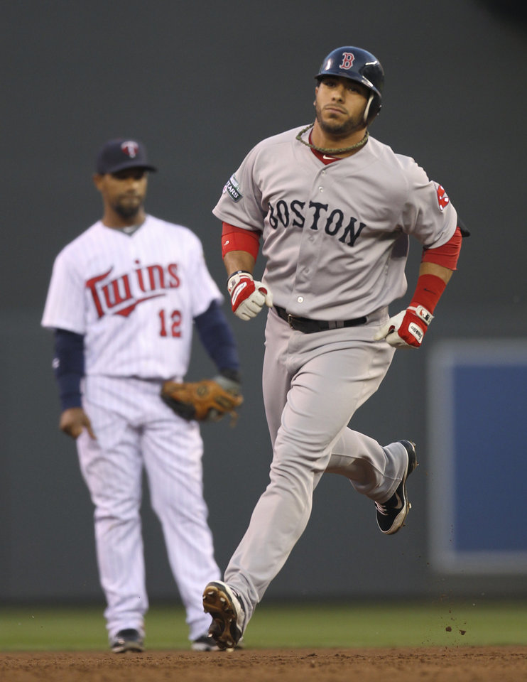 Photo -   Boston Red Sox's Mike Aviles rounds the bases after his three-run home run in the second inning against the Minnesota Twins in a baseball game Wednesday, April 25, 2012, in Minneapolis. (AP Photo/Star Tribune, Jeff Wheeler) ST. PAUL OUT MINNEAPOLIS-AREA TV OUT MAGS OUT