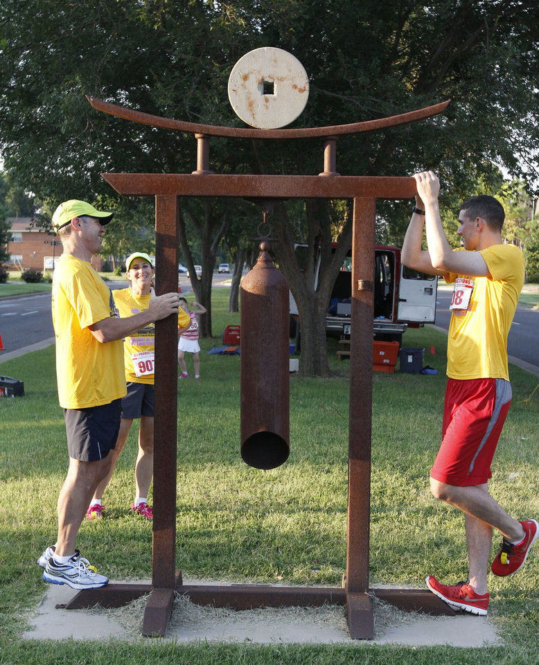 Martin Crawford, left, and his son Chris, warm up before the 5K to Monet run in downtown Edmond, OK, Saturday, August 24, 2013,  Photo by Paul Hellstern, The Oklahoman