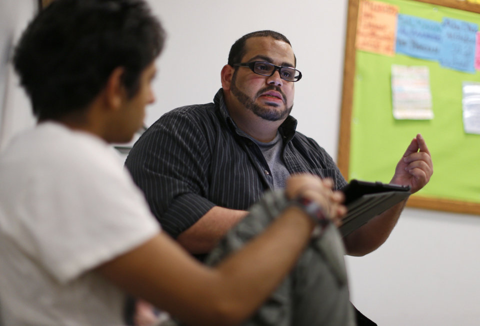 The Islamic Society of Greater Oklahoma's new youth director Abdur-Rahman Taleb talks to a group of youths at the Mercy School complex, 14001 N Harvey.  <strong>BRYAN TERRY - THE OKLAHOMAN</strong>