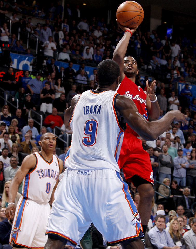 Los Angeles' Chris Paul (3) puts up a shot as Oklahoma City's Russell Westbrook (0) and Serge Ibaka (9) watch during the NBA basketball game between the Oklahoma City Thunder and the Los Angeles Clippers at Chesapeake Energy Arena in Oklahoma City, Wednesday, April 11, 2012. Photo by Bryan Terry, The Oklahoman
