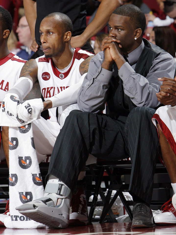 Photo - OU's Willie Warren, right, sits on the bench next to Tony Crocker in the second half during the men's college basketball game between the Oklahoma Sooners and Texas A&M Aggies at Lloyd Noble Center in Norman, Okla., Saturday, March 6, 2010. Texas A&M won, 69-54. Photo by Nate Billings, The Oklahoman