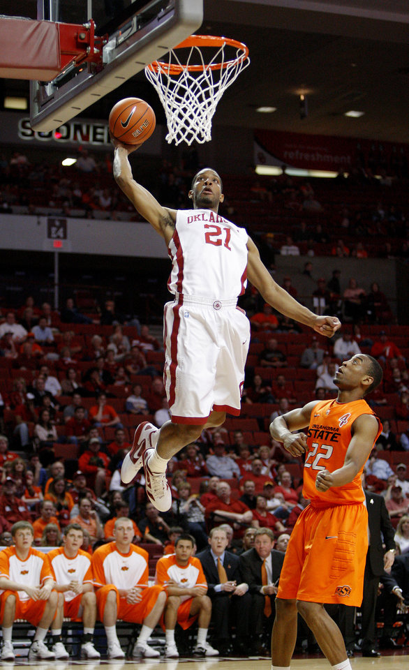 Oklahoma's Cameron Clark (21) goes up for a dunk in front of Oklahoma State's Markel Brown (22) during the Bedlam men's college basketball game between the University of Oklahoma Sooners and the Oklahoma State Cowboys in Norman, Okla., Wednesday, Feb. 22, 2012. Photo by Bryan Terry, The Oklahoman