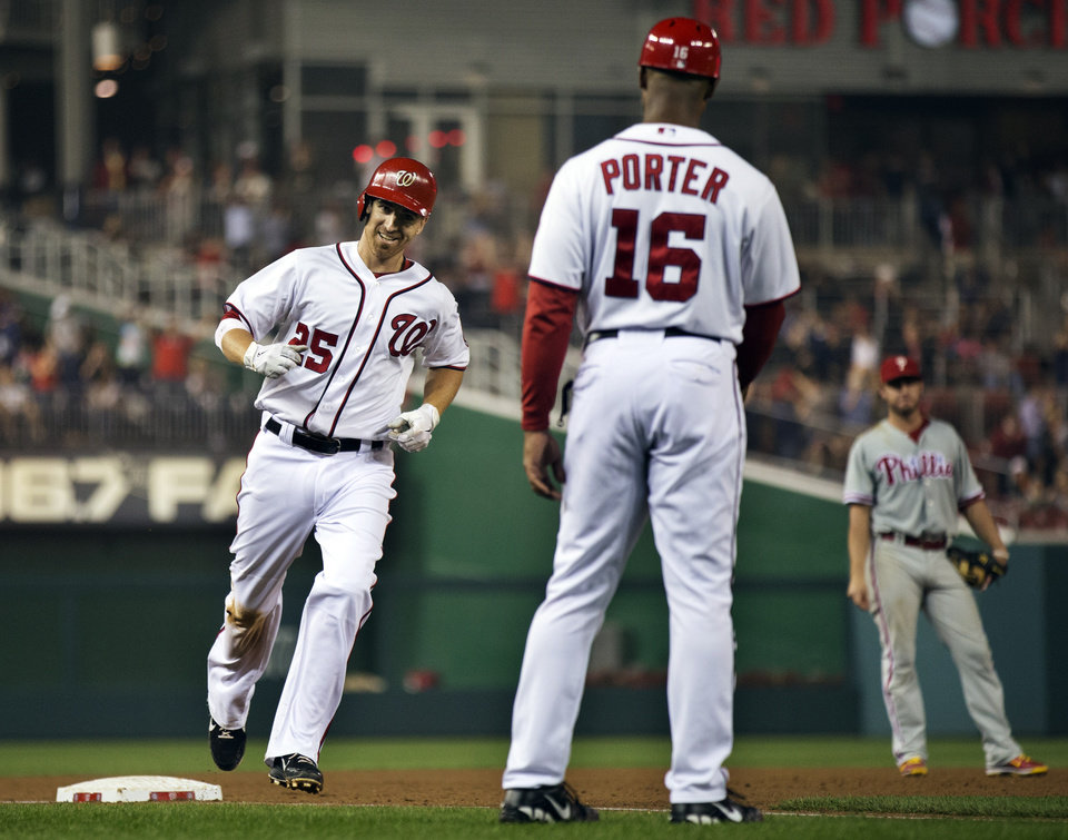 Photo -   Washington Nationals' Adam LaRoche (25) rounds the bases after hitting a home run as third base coach Bo Porter (16) watches during the sixth inning of a baseball game against the Philadelphia Phillies in Washington, Tuesday, Oct. 2, 2012. The Nationals won 4-2. (AP Photo/Manuel Balce Ceneta)