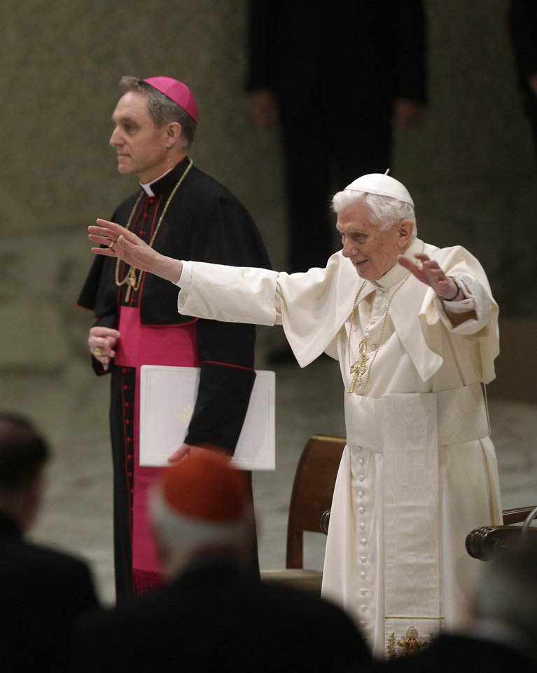 Photo - Pope Benedict XVI is flanked by his private secretary Archbishop Georg Ganswein as he arrives for his weekly general audience at the Paul VI Hall at the Vatican, Wednesday Feb. 13, 2013. Pope Benedict XVI is telling the faithful in his first public appearance since announcing his resignation that he stepping down for