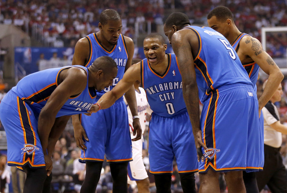 Photo - Oklahoma City's Russell Westbrook (0) huddles with Serge Ibaka (9), Kevin Durant (35), Thabo Sefolosha (25) and Kendrick Perkins (5) during Game 4 of the Western Conference semifinals in the NBA playoffs between the Oklahoma City Thunder and the Los Angeles Clippers at the Staples Center in Los Angeles, Sunday, May 11, 2014. Photo by Nate Billings, The Oklahoman