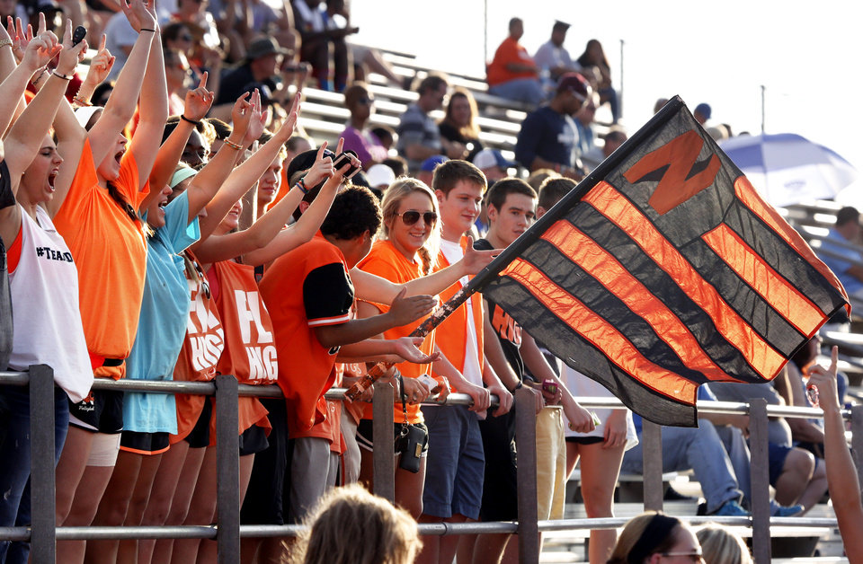 Photo - Norman High School fans cheer at the start of the Top of the World scrimmage at Harve Collins Field in Norman, Okla., on Friday, Aug. 29, 2014. Photo by Steve Sisney, The Oklahoman