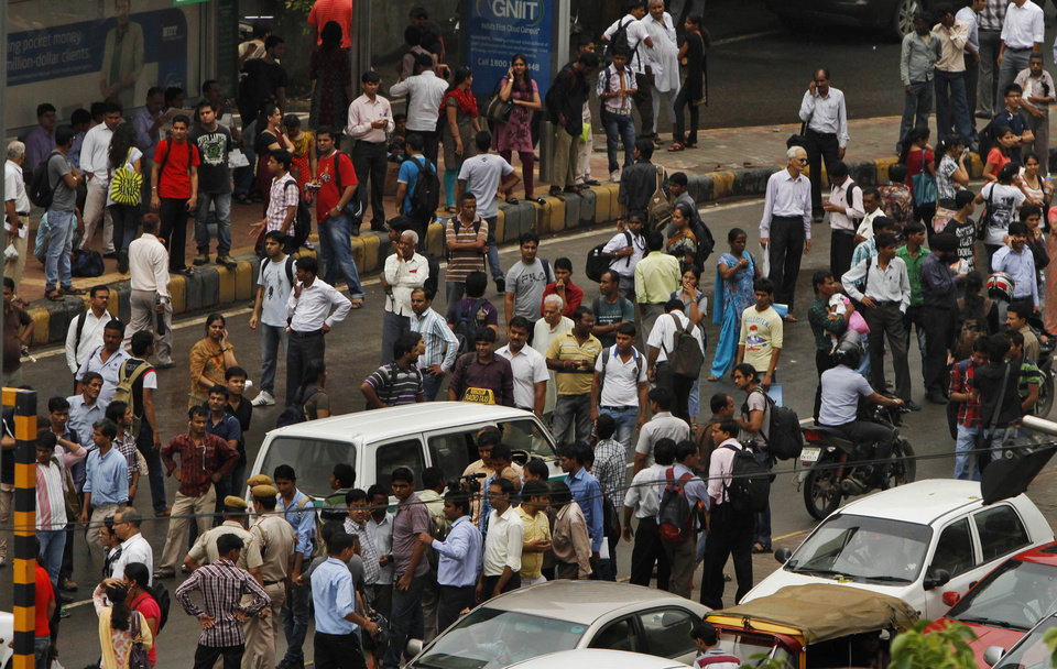 Photo -   Commuters crowd a busy road outside a Metro station after Delhi Metro rail services were disrupted following power outage in New Delhi, India, Tuesday, July 31, 2012. Indian officials say the nation's northern and eastern power grids have failed, leaving about half the country without power. The collapse of the grids Tuesday afternoon came a day after the northern grid failed and left eight states without power for much of the day.(AP Photo/ Rajesh Kumar Singh)