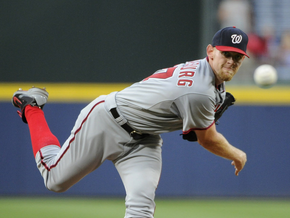 Photo - Washington Nationals pitcher Stephen Strasburg delivers to the Atlanta Braves during the first inning of a baseball game Friday, Aug. 8, 2014, in Atlanta. (AP Photo/David Tulis)