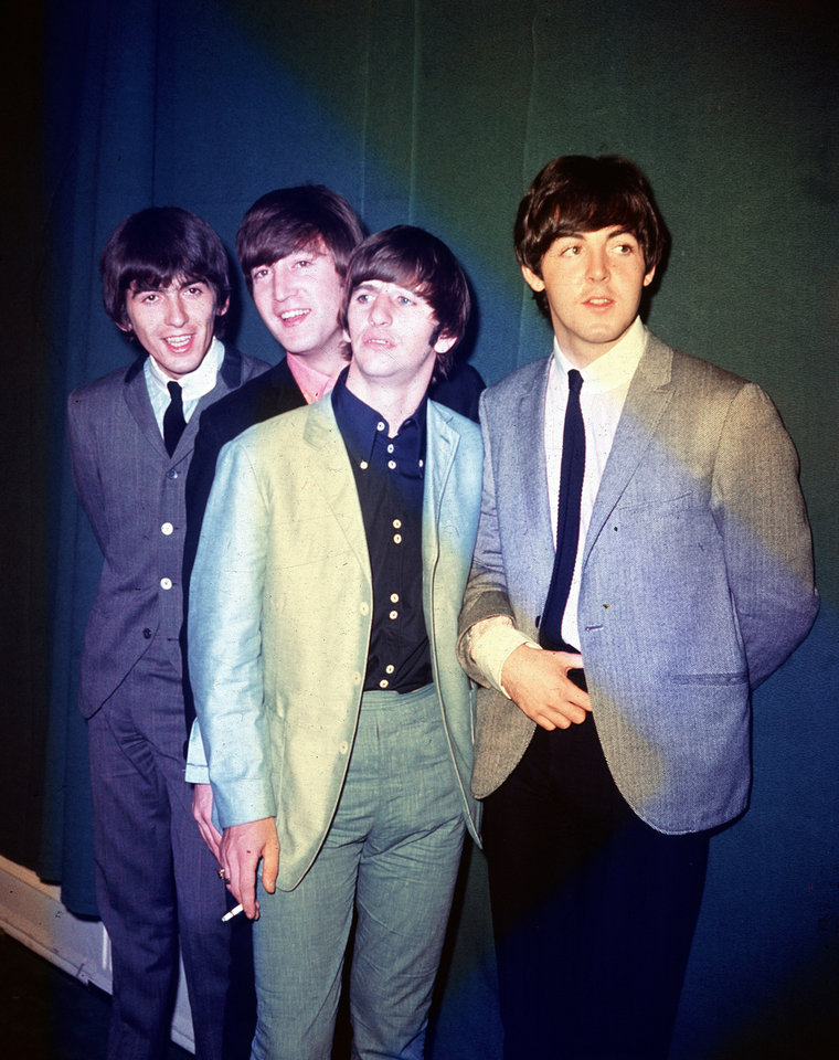 Photo - FILE - This 1964 file photo shows the British rock and roll group, the Beatles, from left, George Harrison, John Lennon, Ringo Starr and Paul McCartney, during their first U.S. tour. Music fans are preparing to celebrate the 50th anniversary of the era-defining band's first appearance in America on