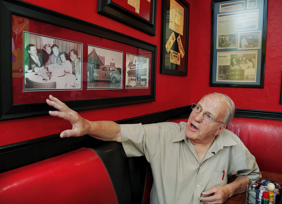 Photo - Jim Barnett talks on Thursday about some of the old photos that hang on the walls inside Beverly's Pancake House. Barnett worked for original owner Beverly Osborne after leaving the military. Barnett has many memories from his years as an employee and a customer at Beverly's. He says he still eats at the restaurant at least once a week.  Photo by Jim Beckel, The Oklahoman  Jim Beckel - THE OKLAHOMAN