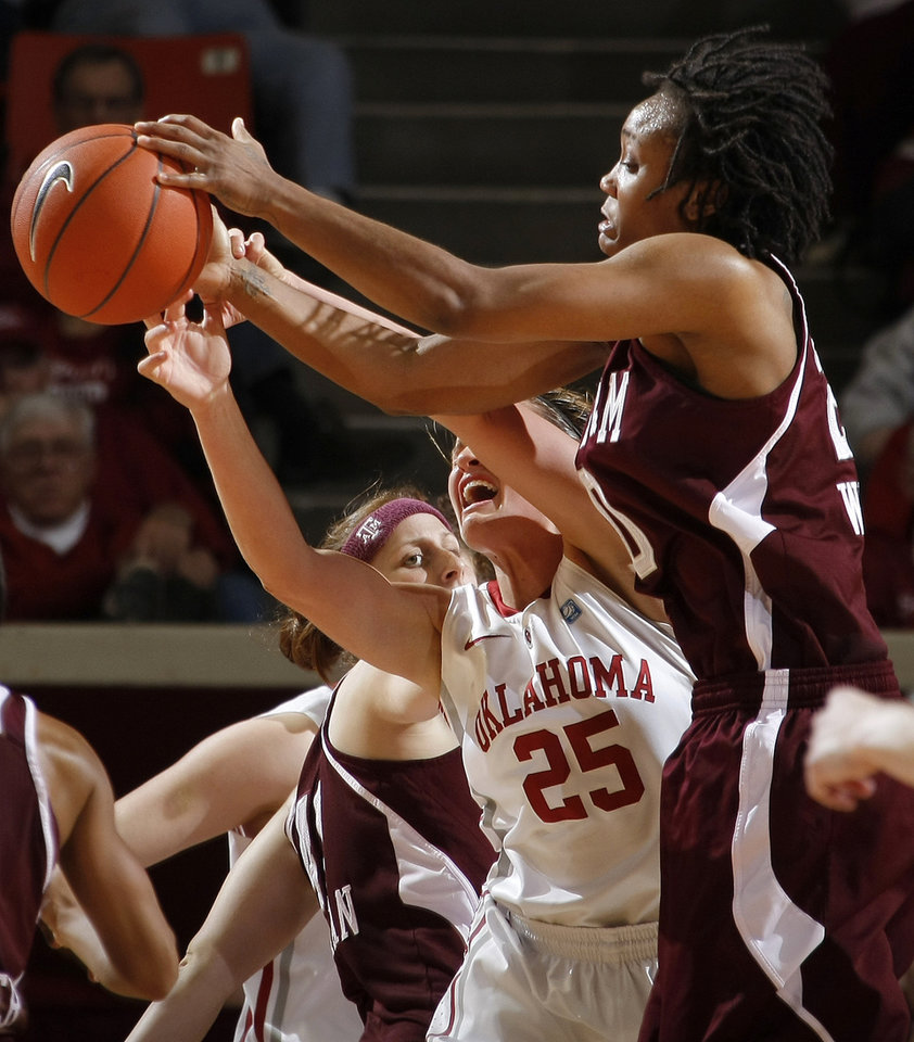 Photo - OU's Whitney Hand (25) fights with Texas A&M's Tyra White (20), right, and Texas A&M's Kelsey Assarian (40) during the Big 12 women's basketball game between the University of Oklahoma and Texas A&M at Lloyd Noble Center in Norman, Okla., Wednesday January 26, 2011.  Photo by Bryan Terry, The Oklahoman