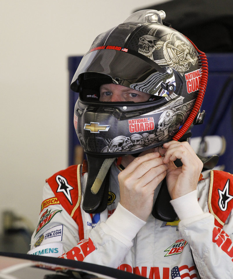Photo - Dale Earnhardt Jr. prepares to get in his car during a NASCAR Sprint Cup practice session at Daytona International Speedway in Daytona Beach, Fla., Thursday, July 3, 2014. (AP Photo/Terry Renna)