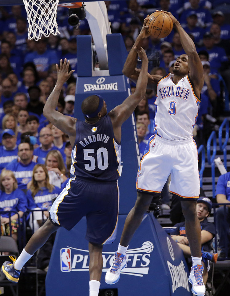 Oklahoma City\'s Serge Ibaka (9) and Memphis\' Zach Randolph (50) battle for a rebound during the second round NBA playoff basketball game between the Oklahoma City Thunder and the Memphis Grizzlies at Chesapeake Energy Arena in Oklahoma City, Sunday, May 5, 2013. Photo by Chris Landsberger, The Oklahoman