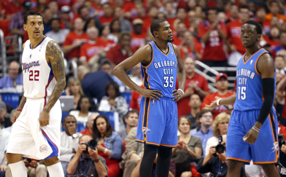 Photo - Oklahoma City's Kevin Durant (35) and Reggie Jackson (15) react as Los Angeles' Matt Barnes (22) looks on during Game 6 of the Western Conference semifinals in the NBA playoffs between the Oklahoma City Thunder and the Los Angeles Clippers at the Staples Center in Los Angeles, Thursday, May 15, 2014. Photo by Nate Billings, The Oklahoman
