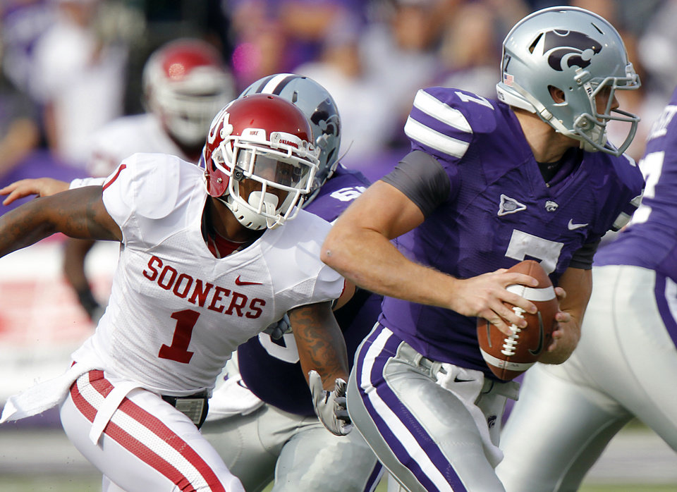 Oklahoma Sooners\' Tony Jefferson (1) puts pressure on Kansas State Wildcats\' quarterback Collin Klein (7) during the college football game between the University of Oklahoma Sooners (OU) and the Kansas State University Wildcats (KSU) at Bill Snyder Family Stadium on Saturday, Oct. 29, 2011. in Manhattan, Kan. Photo by Chris Landsberger, The Oklahoman ORG XMIT: KOD