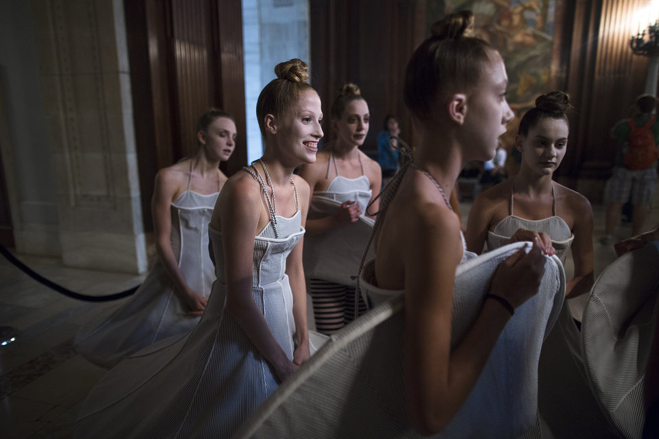 Photo -   Dancers wait outside the presentation space before the Thom Browne Spring 2013 collection is modeled during Fashion Week in New York, Monday, Sept. 10, 2012. (AP Photo/John Minchillo)