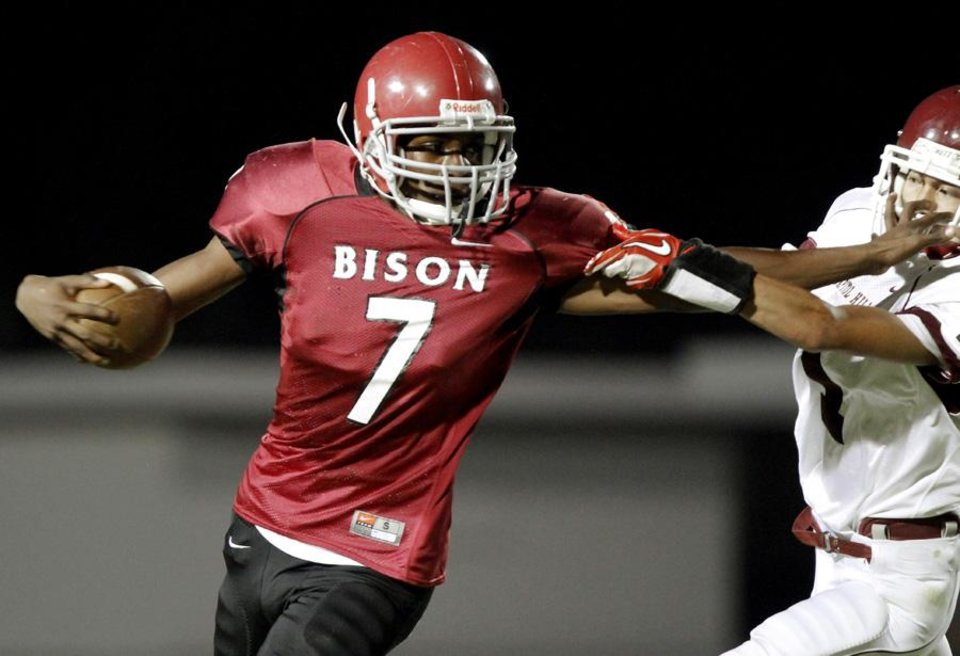 Photo -  Terry Davis of Oklahoma Centennial fights off Capitol Hill's Denny Do during a high school football game at Star Spencer in Oklahoma CIty, Thursday, September 1, 2011. Photo by Bryan Terry, The Oklahoman ORG XMIT: KOD