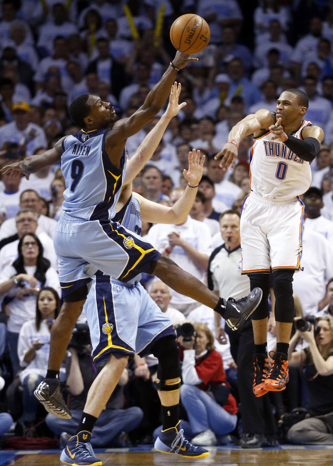 Photo - Memphis' Tony Allen (9) tries to steal a pass from Oklahoma City's Russell Westbrook (0) during Game 5 in the first round of the NBA playoffs between the Oklahoma City Thunder and the Memphis Grizzlies at Chesapeake Energy Arena in Oklahoma City, Tuesday, April 29, 2014. Photo by Sarah Phipps, The Oklahoman