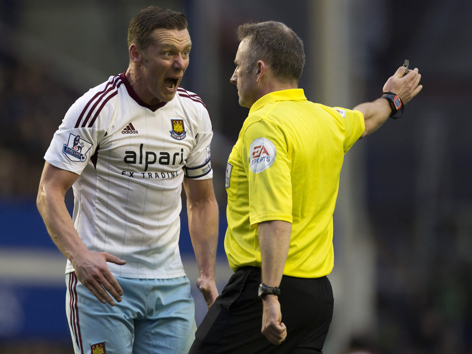 Photo - West Ham United's Kevin Nolan, left, remonstrates with referee John Moss during his team's 1-0 loss at Everton during their English Premier League soccer match at Goodison Park Stadium, Liverpool, England, Saturday March 1, 2014. (AP Photo/Jon Super)