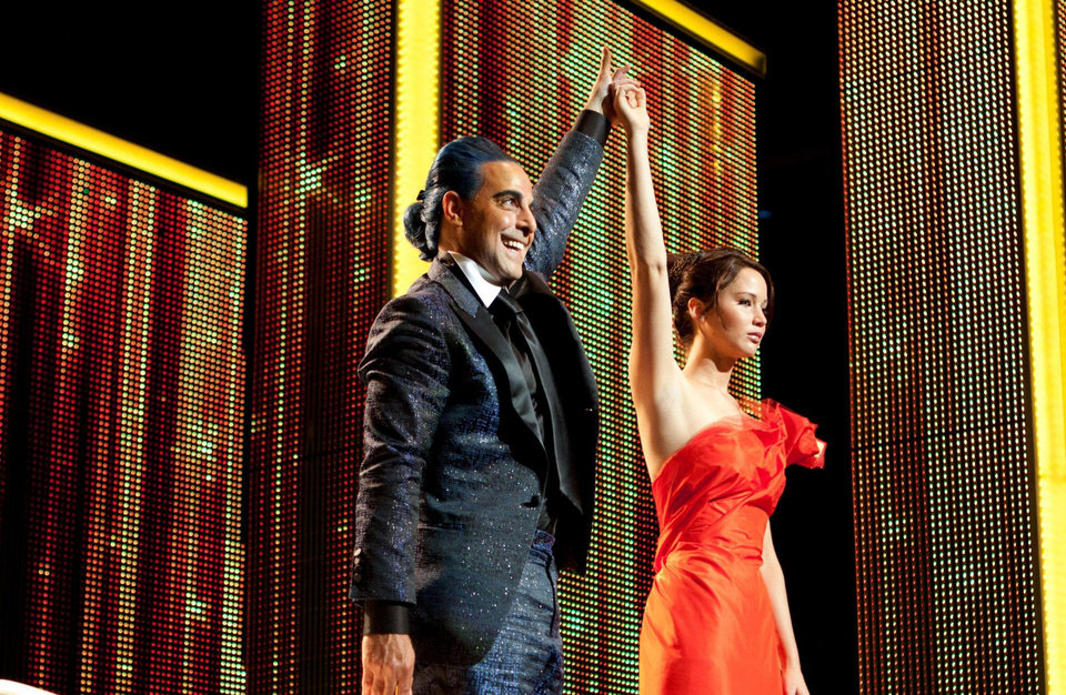 "Caesar Flickerman (Stanley Tucci) and Katniss Everdeen (Jennifer Lawrence) in ""The Hunger Games."" PHOTO BY MURRAY CLOSE PROVIDED. <strong>Photo credit: Murray Close</strong>"