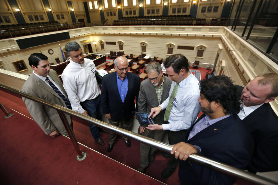 Photo - A team of architects and engineers producing a 3D map of the State Capitol building, look at mechanical systems in the Senate Chambers of the Oklahoma State Capitol in Oklahoma City, OK, Friday, May 29, 2015. From left are Trait Thompson, Kyle Nelson, Fred Schmidt, Steve Scovel, David Ketch, Xavier Neira, and Brian Sauer. The results of the mapping will be used to guide the Capitol's biggest-ever remodel and repair project.   Photo by Paul Hellstern, The Oklahoman
