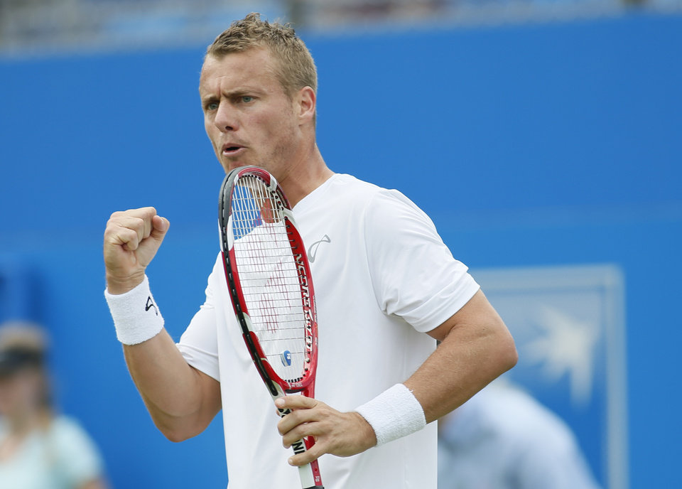 Photo - Australia's Lleyton Hewitt celebrates after winning a point against Daniel Gimeno-Traver of Spain during their first round Queen's Club grass court tennis tournament match in London, Monday June 9, 2014. (AP Photo/Alastair Grant)