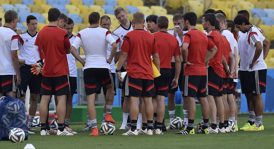 Photo - Germany's head coach Joachim Loew, center, talks to his team during an official training session one day before the World Cup quarterfinal soccer match between Germany and France at the Maracana Stadium in Rio de Janeiro, Brazil, Thursday, July 3, 2014. (AP Photo/Martin Meissner)