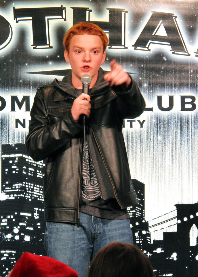 "In this Dec. 16, 2012 photo, teenage comedian Eric Kurn performs his stand-up act during the ""Kids 'N Comedy"" show at Gotham Comedy Club in New York. Children can get grownup laughs at a monthly comedy show in Manhattan where homework, parents and the awkwardness of adolescence rule the stage. (AP Photo/Larry Neumeister)"