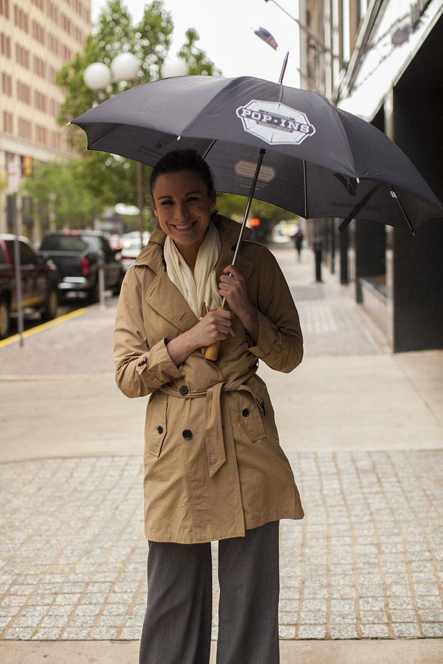 Rachel Prince, VI Marketing and Branding social media strategist, shows off a new Pop-Ins umbrella.  <strong>Courtesy of VI Marketing and Branding</strong>