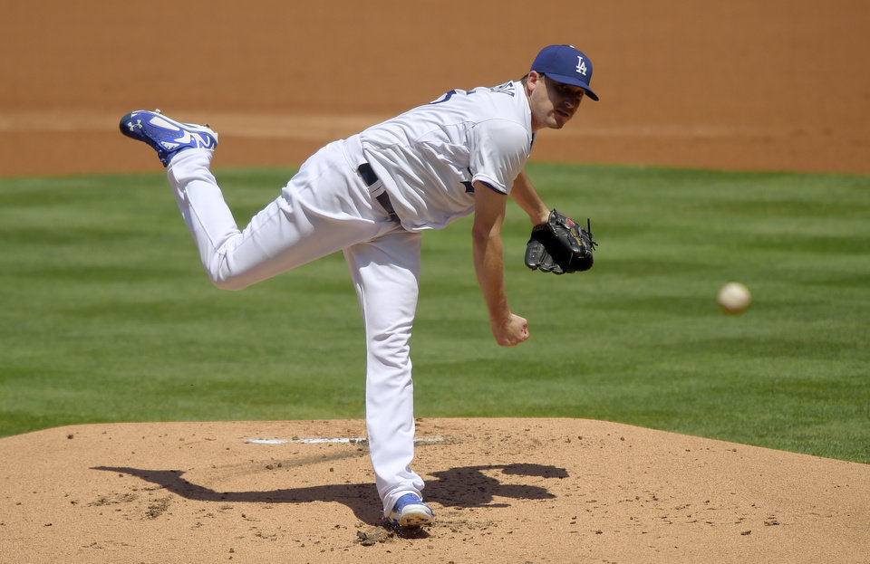 Photo - Los Angeles Dodgers starting pitcher Kevin Correia throws to the plate during the second inning of a baseball game against the New York Mets, Sunday, Aug. 24, 2014, in Los Angeles. (AP Photo/Mark J. Terrill)