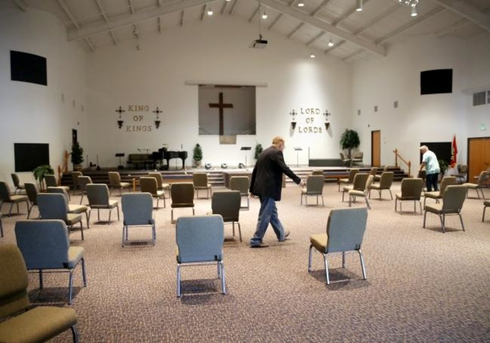 Photo -  The Rev. Dan Maxwell prepares the sanctuary of Chisholm Creek Baptist Church, 17600 N Western, for a worship service set for Sunday, the first day the in-person worship gathering is permitted in the era of the coronavirus pandemic. [Sarah Phipps/The Oklahoman]