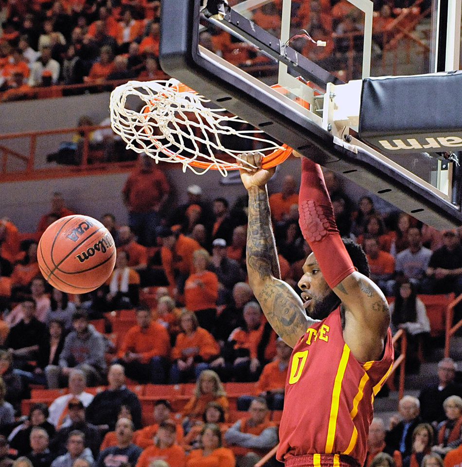 Photo - Iowa State's DeAndre Kane dunks the ball during the first half of an NCAA college basketball game in Stillwater, Okla., Monday, Feb. 3, 2014. (AP Photo/Brody Schmidt)