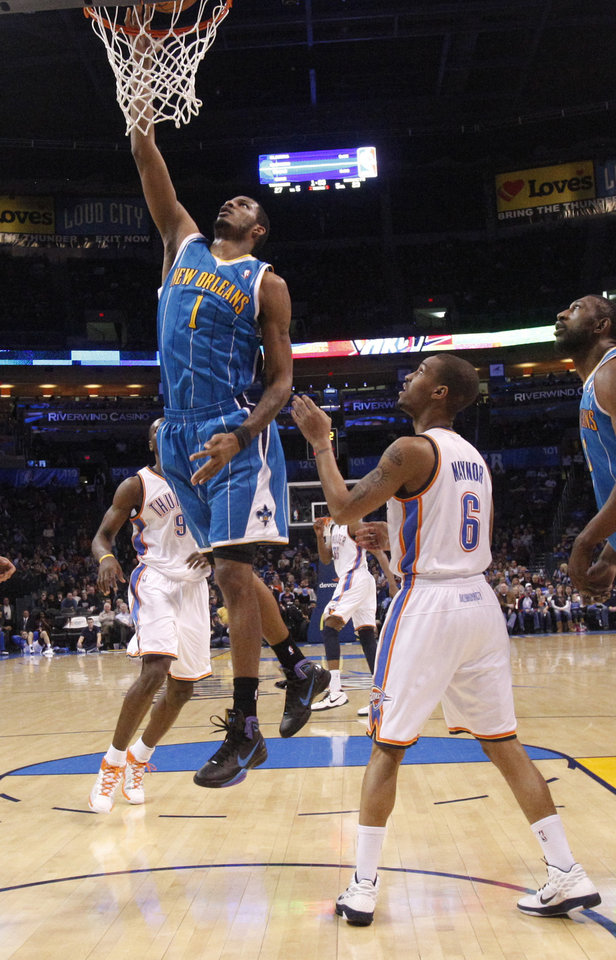 Photo - New Orleans' Trevor Ariza (1) shoots a lay up over Oklahoma City's Eric Maynor (6) during the NBA basketball game between Oklahoma City Thunder and New Orleans Hornet, Wednesday, Feb. 2, 2011 at the Oklahoma City Arena. Photo by Sarah Phipps, The Oklahoman