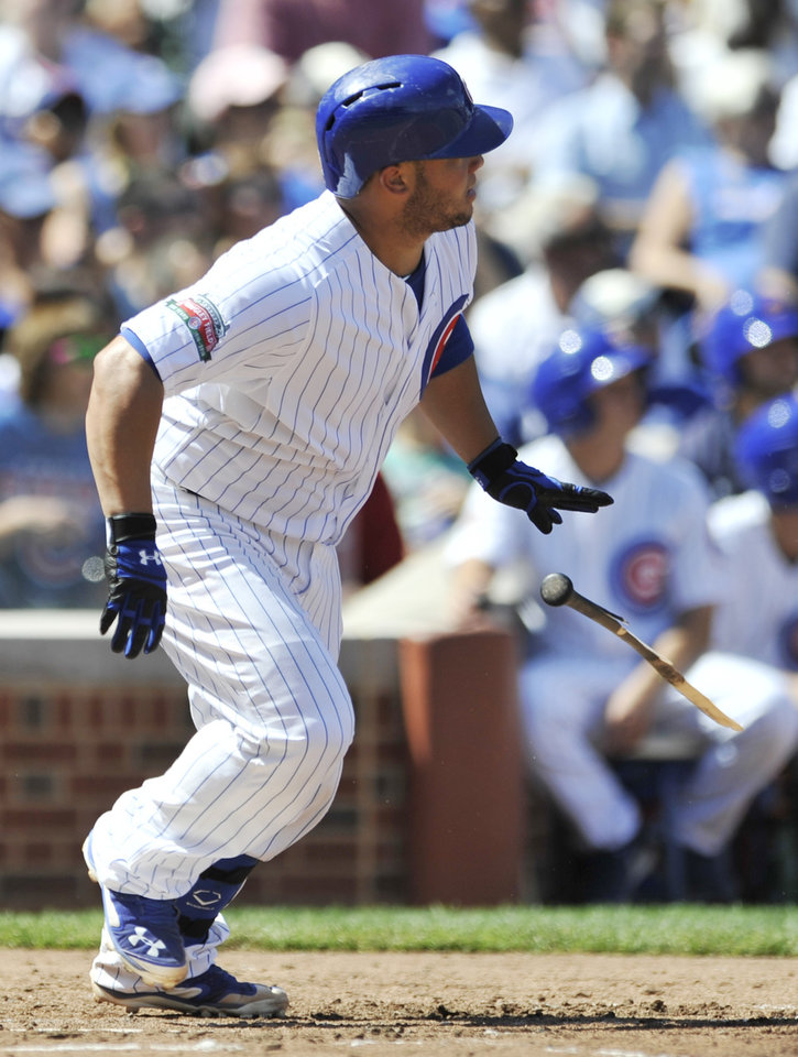 Photo - Chicago Cubs' Welington Castillo watches his RBI single during the second inning of a baseball game against the Milwaukee Brewers in Chicago, Monday, Sept. 1, 2014. (AP Photo/Paul Beaty)
