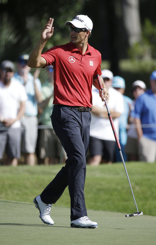 Photo - Adam Scott of Australia, waves after making a birdie putt on the 14th hole during the second round of The Players championship golf tournament at TPC Sawgrass, Friday, May 9, 2014 in Ponte Vedra Beach, Fla. (AP Photo/John Raoux)