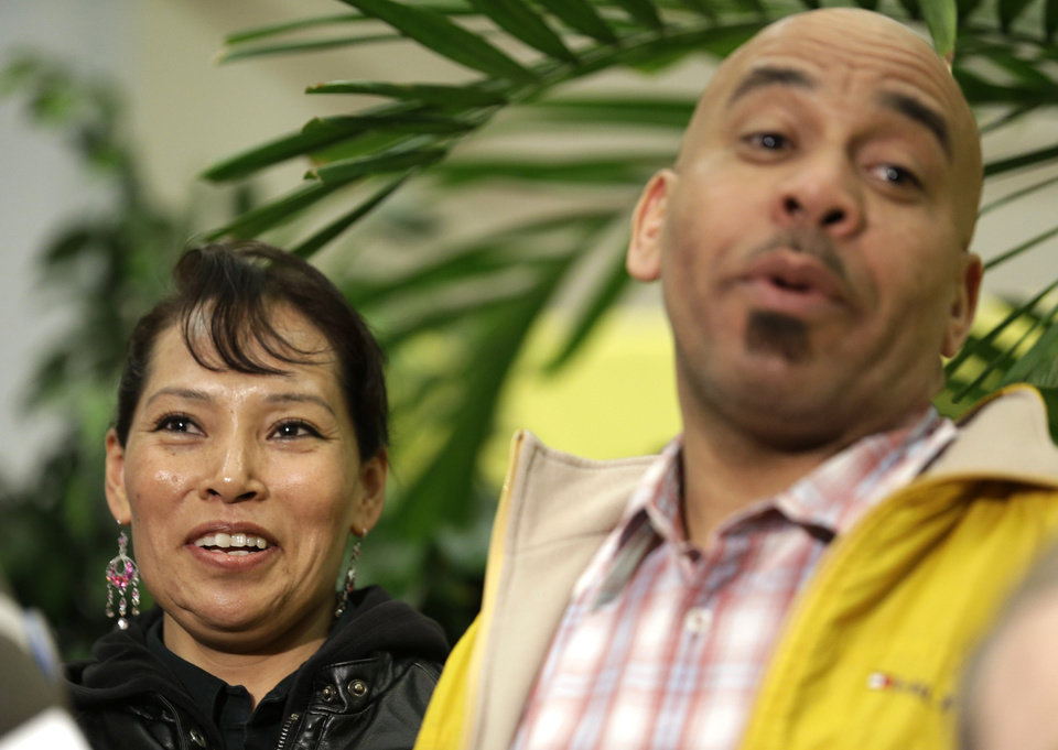 Photo - Pedro Quezada, right, the winner of the Powerball jackpot, stands next to his wife, Ines Sanchez, during a news conference at the New Jersey Lottery headquarters, Tuesday, March 26, 2013, in Lawrenceville, N.J. Quezada , 44, won the $338 million jackpot with the winning ticket he purchased at Eagle Liquors store in Passaic, N.J. (AP Photo/Julio Cortez)