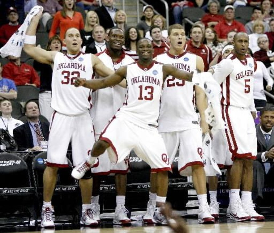 Photo - From left, OU's Taylor Griffin, Ryan Wright, Willie Warren, Blake Griffin, and Tony Crocker celebrate near the end of their win in a first round game of the men's NCAA tournament between Oklahoma and  Morgan  State in Kansas City, Mo., Thursday, March 19, 2009. PHOTO BY BRYAN TERRY