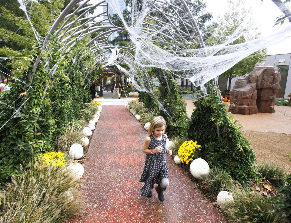 A child walks on a path at Pumpkinville at the Myriad Botanical Gardens in Oklahoma City.  Photo by PAUL HELLSTERN, the Oklahoman