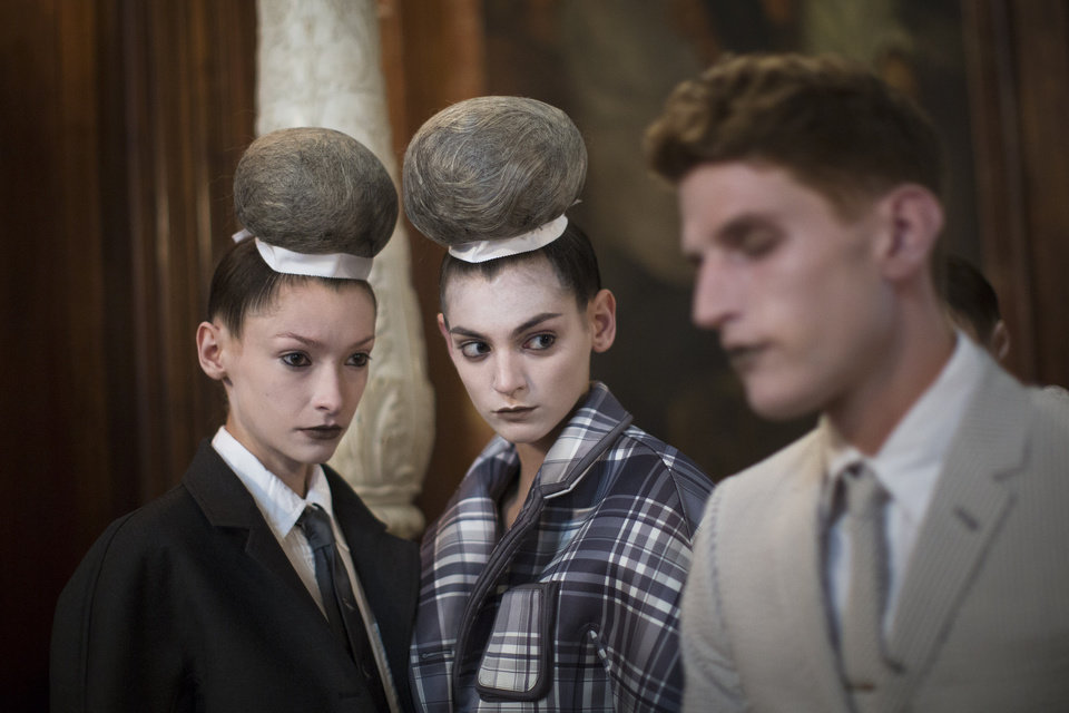 Photo -   Models wait outside the presentation space before the Thom Browne Spring 2013 collection is modeled during Fashion Week in New York, Monday, Sept. 10, 2012. (AP Photo/John Minchillo)