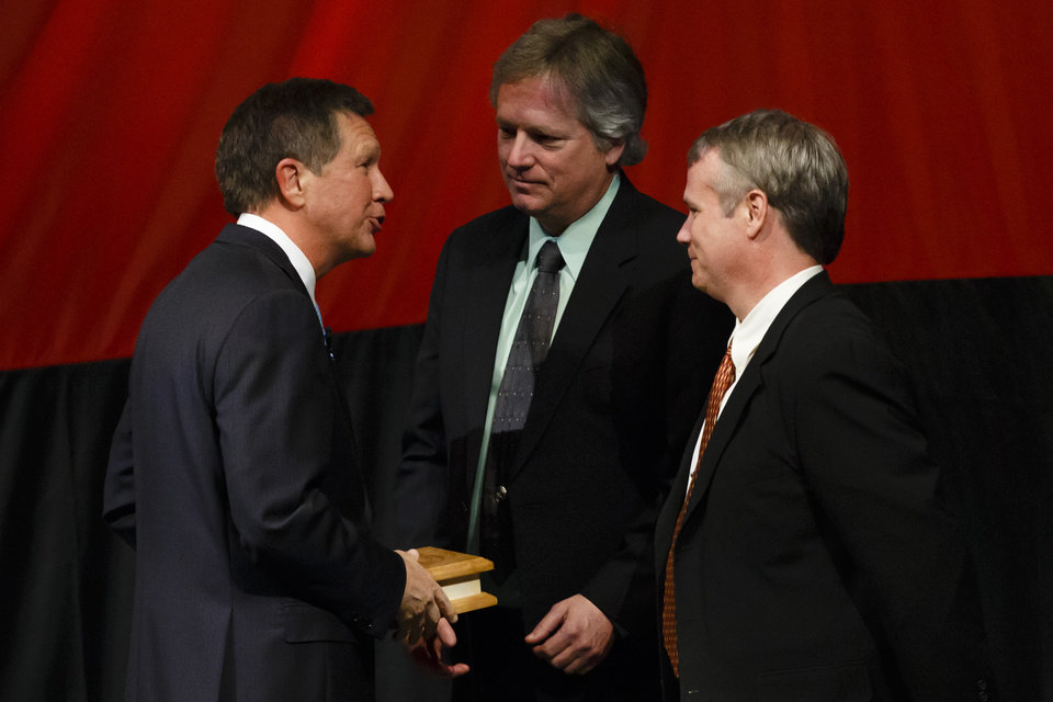 Ohio Gov. John Kasich with Rick and Mark Armstrong as they accept the Governor's Courage Award on behalf of the father Neil Armstrong during the State of the State address at Veterans Memorial Civic and Convention Center in Lima, Ohio, Tuesday, Feb. 19, 2013. (AP Photo/Rick Osentoski)
