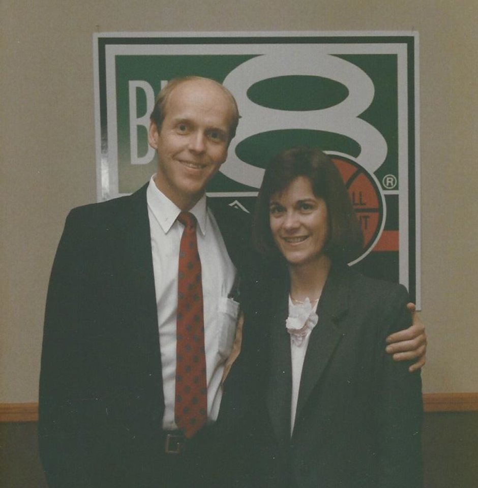 Photo - Bill Hancock with his wife Nicki at Big Eight headquarters in the late 1970s.  PHOTO PROVIDED