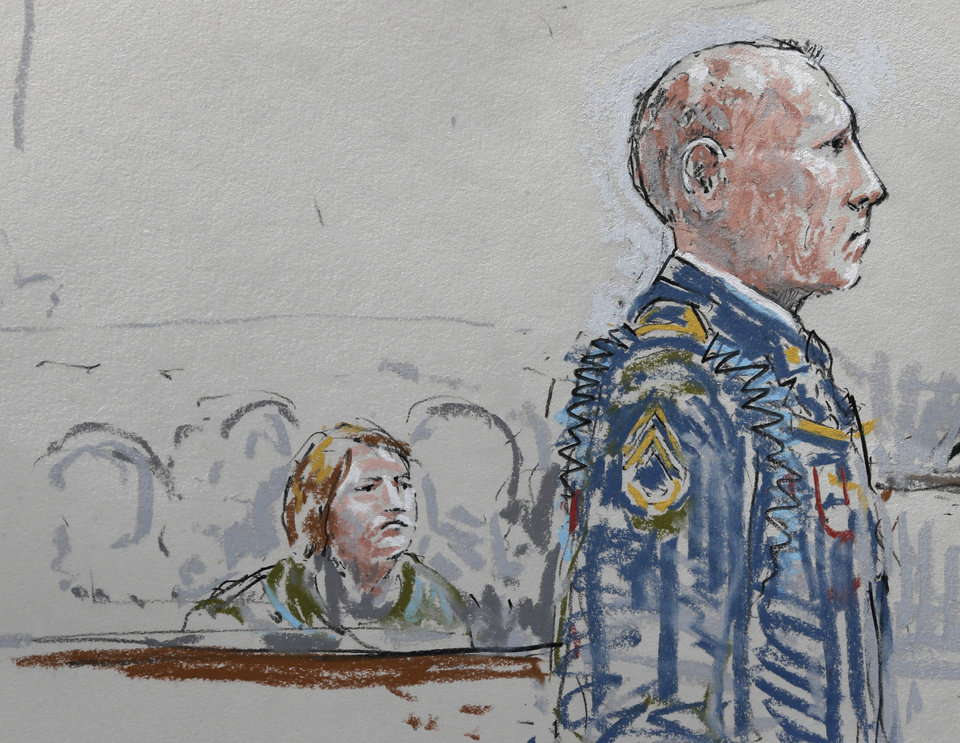 Photo - In this courtroom sketch, U.S. Army Staff Sgt. Robert Bales, right, stands in a military courtroom as Bales' wife Kari Bales looks on at left, Wednesday, June 5, 2013, during a plea hearing at Joint Base Lewis-McChord in Washington state. Robert Bales pleaded guilty to multiple counts of murder, stemming from a pre-dawn attack on two villages in Kandahar Province in Afghanistan in March, 2012. (AP Photo/Peter Millett)