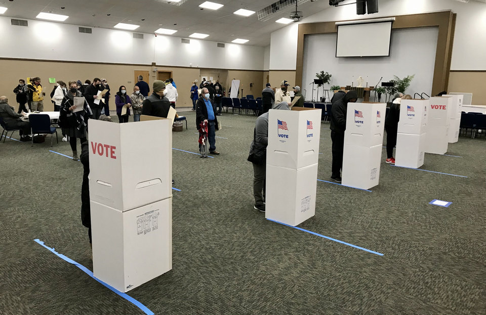 Photo - Voters socially distance as they wait their turn to vote Nov. 3, 2020, at Church of the Good Shepherd in Yukon, Okla. Photo by Chris Landsberger