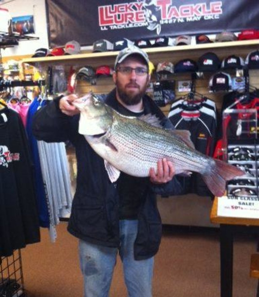 Photo -  Lambert Dunn caught this 17.9-pound striped bass hybrid at Lake Hefner on Saturday. The fish has been submitted to the Oklahoma Department of Wildlife Conservation as a new lake record.
